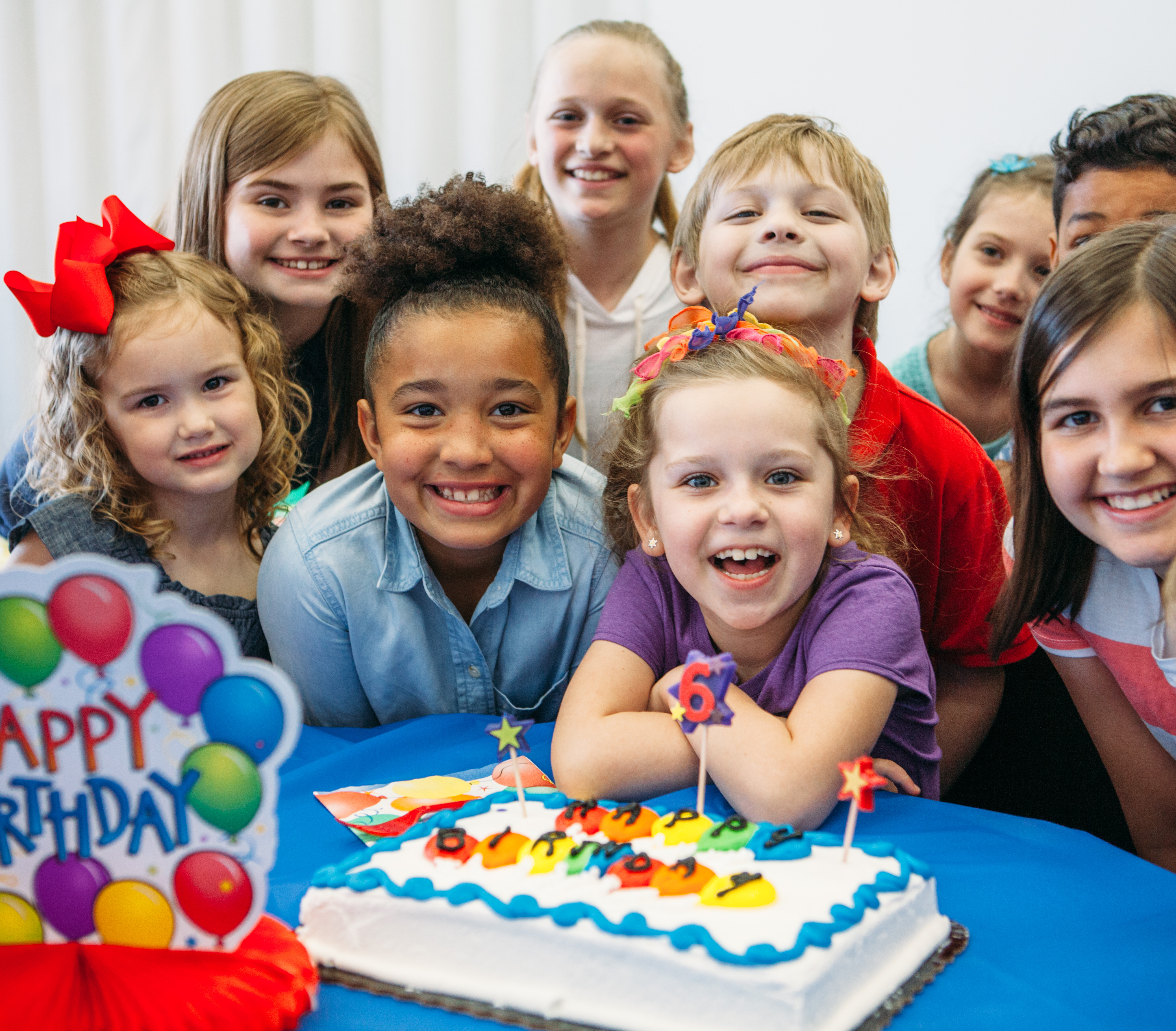 Kid's Celebrating at Birthday Party Over Cake